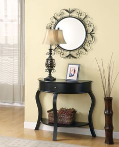 Vignette: Mirror-lamp-picture frame-basket underneath-spray next to table