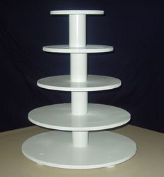 "6, 8, 10, 12, 14""  masonite  circles,  Using pvc pipe as spacers, all thread through center with threaded bolt at top, drawer knobs for feet.    Thanks to all the other creative ccr's for their examples, sketches and directions for their cupcake towers."