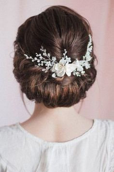 This one is pretty universal headpiece that you can use with a variety of special occasion and bridal hair styles: Try it across the low bun - as pictured; Try it as a hair comb simply hiding the both ends under hair; Try it as a hair vine across the forehead or crown - a larger size may be required - please see options. This gorgeous bridal and special occasion headpiece hair adornment piece is Intricately decorated with some floral / flower components, exquisite crystals and premium glass…