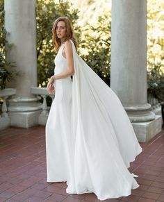 Silk Cape Bridal Gown Solene is fiercely feminine and entirely sophisticated. Featuring a cape that takes its turn as a bridal train, this dress is the chic-est of bridal looks. Bridal Dresses, Wedding Gowns, Bridal Gown, Wedding Bells, Wedding Shoes, Wedding Stuff, Cape Dress, Bridal Looks, Vintage Dresses