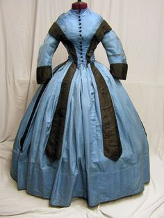 """1860's Blue & Black   bust 32; waist 21, front skirt length 47"""", hem 170 inches. Poor condition, silk splitting, 3 lost buttons, seam splitting, age discoloration.  Lining excellent condition."""