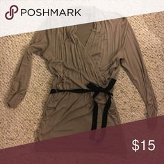 Brown Maurice's top Tan/brown top from Maurice's. Black tie belt with loops on both sides. Small pin hole on left side which you can barely see. Criss cross front. The sleeves are 3/4 length and have cinched sides Maurices Tops Blouses