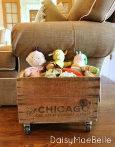 Cutest Farmhouse Ever @ DaisyMaeBelle Like the idea of an old box with rollers. Cute idea for a toy box or whatever