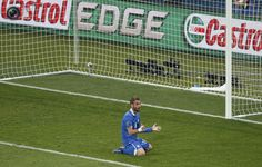 Italy's De Rossi reacts after missing a chance to score during their Euro 2012 quarter-final soccer match against England at the Olympic stadium in Kiev. MICHAEL DALDER/REUTERS