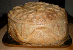 A Tudor Christmas Pie  Excerpt: A Tudor Christmas Pie consisted of a Turkey stuffed with a goose  - then stuffed with a chicken – then stuffed with a partridge and finally stuffed with a pigeon – all of this was put in a pastry case, called  cheerfully – a coffin! (kind of makes the turducken look lame in comparison!)
