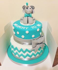 Two tier Baby shower cake for a 'Mummy to be', with an elephant cake topper. Colours teal, grey and white.