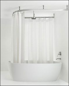 Rain shower head with standing tub. Throw in a cuter shower curtain of course