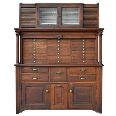 Oak Medical Cabinet with Tambour Doors, circa 1920 | From a unique collection of antique and modern cabinets at https://www.1stdibs.com/furniture/storage-case-pieces/cabinets/
