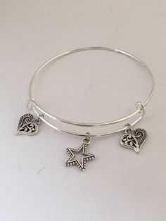 Charm bangle bracelet by Pinkarrowheadranch on Etsy https://www.etsy.com/listing/525173299/charm-bangle-bracelet