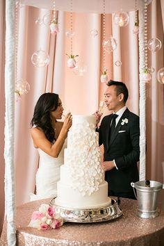 Five-Tier White Wedding Cake with Cascading Sugar Flowers | Brides.com