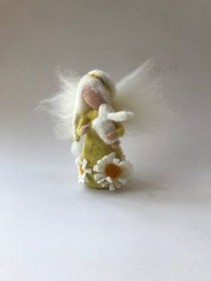 Easter Fairy with a white bunny. Waldorf education standing doll. Its arms are flexible. Size about 6 inches high. Your purchase will be sent within 5/10 business days. If you need something to be shipped faster, please contact us. We ship from Germany to keep the shipping cost as low as