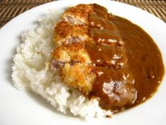Katsu Kare - Tonkatsu, Japanese breaded and fried pork cutlet with curry sauce. Katsu kari is a popular meal in japan. It is typically served on Japanese short grained rice.