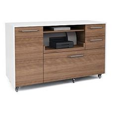 The Mobile Credenza in modern design in white with walnut - includes a locking lateral file drawer for files, a printer tray, a paper storage shelf, supply drawers and an adjustable storage cabinet. Paper Storage, Storage Drawers, Storage Shelves, Storage Spaces, Storage Cabinets, Contemporary Furniture, Contemporary Office, Buffet, Modern