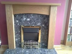 """The after shot of Amanda Cravens fireplace with the Contemporary Arch Oak and new fire installed. """"I want to say how friendly, professional and helpful ALL your staff are. Thank you"""" - Amanda Granite Hearth, Marble Hearth, Contemporary Gas Fires, Oak Fire Surround, Inset Stoves, Black Granite, Fireplace Surrounds, White Marble, Solid Oak"""