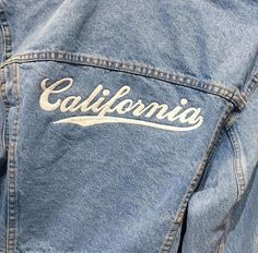 """Denim jacket with """"California"""" on the back."""