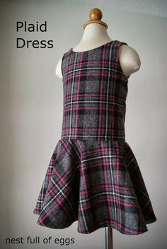 This drop waist plaid dress by Rachel from Nest Full of Eggs is so sweet!  She shares a free pattern for making it.