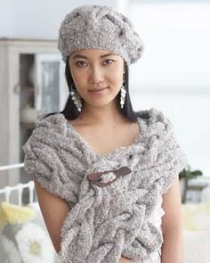 Elegant wrap and beret with rich folded cables. Shown in Bernat Soft Boucle.