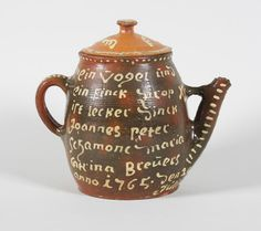 A Dutch slipware coffee pot and associated cover Dated 1765.