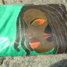 My work-Acrylic paint on a Clutch. Only made 2...
