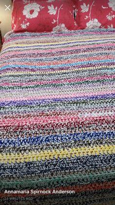 Yarn scraps with a strand of white yarn