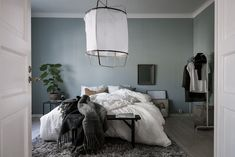 I think this blue-green bedroom is so stylish. The wall color fits the flooring and furniture perfectly and I love how the brass office lamp looks against that wall. The Ay Illuminate fabric pendant lamp is the statement piece that … Continue reading →