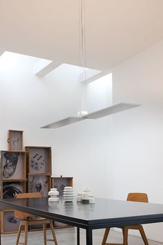 PUZZLE: Lamps of extreme style that disappear into our ceilings and walls. Installed at different angles leaving space for the light that comes from dimmable led with direct power supply to the ac line voltage. Creating an intriguing play of light. http://www.studioitaliadesign.com/prodotto.asp?lingua=eng&id=728