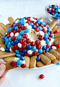 Cream cheese blended with cake mix and covered with Skittles America Mix, makes for a delightfully sweet appetizer or dessert.