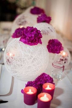 String Spheres: These add a whimsical touch to any table decor.  Blow up balloons to a medium size, so they keep a ball shape.  Wrap the balloons with yarn and cover them with fabric stiffener.  When completely dry, pop the balloons an remove them.  Arrange the spheres in a line down the center of a long table with accents of flowers and candles.  You can also hang these from ceiling for added elegance.  Lights can be added too, like this cluster of three spheres from StuffByJenB on Etsy!