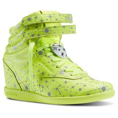 LA designer Melody Ehsani takes another Reebok Classic to new heights with this wedge cut Freestyle Hi. The reflective zodiac print symbolizes the wearer's self-discovery and unique perspective, while additional details keep feet feeling grounded, guided, and bright.