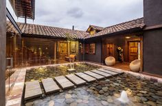 Red clay tiles give the roof of the home a distinct indentity