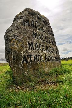 stone marker for the  Athol clansmen slaughtered at Culloden ... MacGillivray's, MacLean's and MacLachlan's.