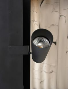 Blackened steel. A projector lighting fixture by PSLab.