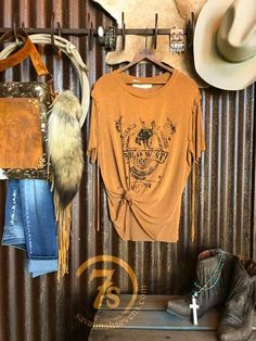 "The Wild West Show - ""Wild West Rodeo, Pecos, Texas"" Graphic Fringe Tee. Tri-blend pumpkin tan color. Rustic black graphics. Tied fringe sleeves. Very soft and a bit slinky. Intended oversized fit. Super cute knotted or side tucked. Small fits size 4/6 very loose."