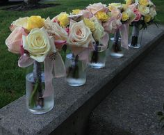 Bridesmaid bouquets in pale pink and yellow. So girly and pretty loves these!! Hopper flowers.