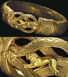 Greek gold bracelet, Hellenistic period, 300 B.C.   Formed from a hollow hoop fashioned from sheet, convex on the exterior, each end with a collar terminal secured by a pin, its tip with granulation, the collars each with twisted wire filigree palmettes framed by beaded, small birds at the outer edges of the left collar, a Herakles knot at the center, centered by a die formed lion running to the left, a small frontal Pan seated to the left  playing the pipes, 12.3 cm wide. Private collection