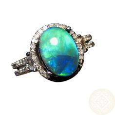 Genuine Black Opal with Blue, Aqua and Green Colors prong set in a 14k Gold Ring with Diamonds. One Only and available in any Ring Size and Gold Preference. http://www.flashopal.com/Black-Opal-Diamond-Ring-14k-Gold-Bright-Blue-Aqua-Gem/ #flashopal