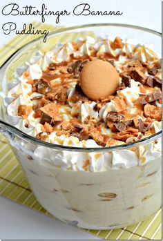 1 can sweetened condensed milk      1 cup milk      2 tablespoons cornstarch      3 large eggs, beaten      2 teaspoons vanilla extract      1 tub Cool Whip      1 box Nilla Wafers      4 bananas, peeled, sliced      1 Butterfinger, crushed