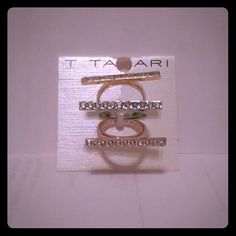 T Tahari 3 Piece Stick Linear Rings Brand new never worn beautiful Silver, Gold, Rose Gold color rings with rhinestones.size 5, brand new! Tahari Jewelry Rings