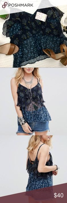 "Free People ""All Things Frill"" cami tank top shirt Adorable sheer Free People cami top. It is lined along the bust and sheer through the back and tummy area. Beautiful floral print through out. Free People Tops Tank Tops"