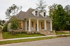pretty, but more of a black and white color scheme with different color bricks - The Highland Homes 2011 Parade Home