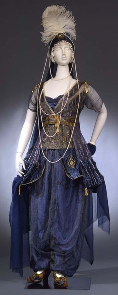 Costume of odalisque. 1911. Dress for 'Masquerade Ball' consisting of waistcoat, breeches, belt, veil, toque, socks, shoes. 'Toque' turban with headpiece and feather.