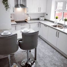 Achieve a neutral colour scheme by using our Greenwich Gloss White kitchen cabinets and a concrete effect worktop.  On-trend concrete worktops are polished, stylish and can be used to transform any space.