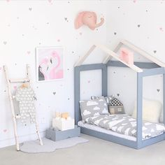 Such a darling room, with our heart decals scattered over white walls!  Pictured here in regular and mini size. Thanks for the photo @jujuzozokids xo