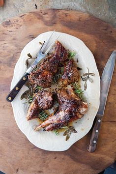 Roasted Lamb with Rosemary (Arni me Dendrolivano) - This technique of roasting lamb over a bed of rosemary sprigs lends this Greek classic a smoky, herbal flavor.
