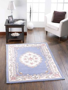 Intricate floral designs. This traditional rug is sure to give your decor a true vintage look. #traditionalrugs  #bluerugs #bluetraditionalrugs #largerugs #purewoolrugs #woolrugs #circlerugs #halfmoonrugs #luxuryrugs