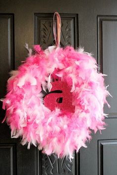Upcoming Princess Party?  A feather boa wreath can go from door decor to a sweet momento after the party is over.