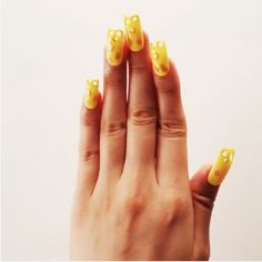 This cheese-inspired nail art is so convincing it might make you hungry.