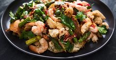Watch and learn how to make a warm and hearty sheet tray shrimp dinner with vegetables.