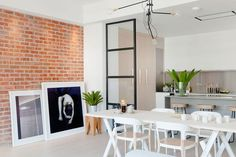 Brick wall and art work give the London apartment an NYC-inspired look