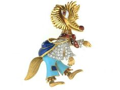 This is a beautiful, whimsical estate brooch with amazing detail. This vintage brooch is Italian made, crafted from 18k gold and colorful touches of enamel. The vagabond fox's shirt is made from dozens of pave set round brilliant diamonds, and this charming estate piece is finished with a bright ruby eye.
